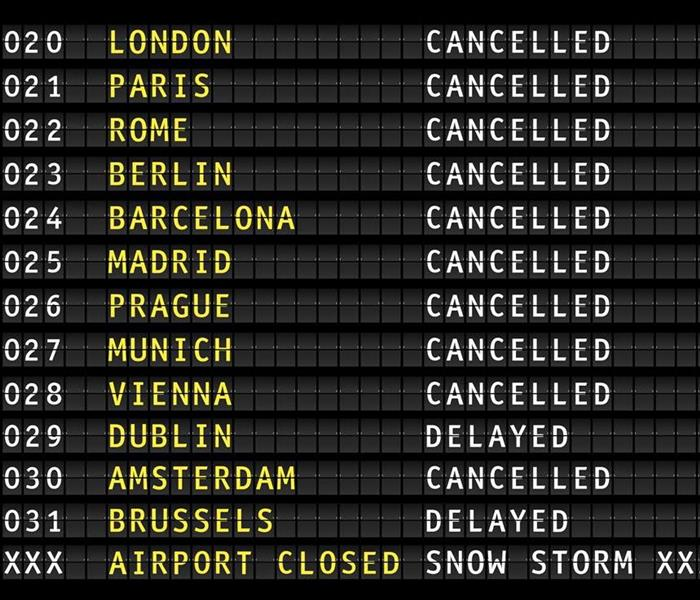 Flight information on an airport showing cancelled flights because of a thunderstorm